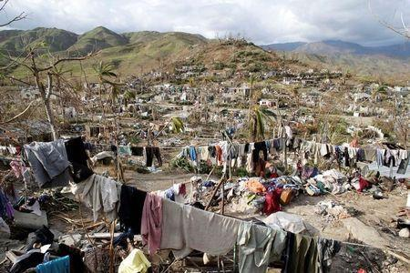 Clothes hang in an area destroyed by Hurricane Matthew in Les Anglais, Haiti, October 11, 2016. REUTERS/Andres Martinez Casares