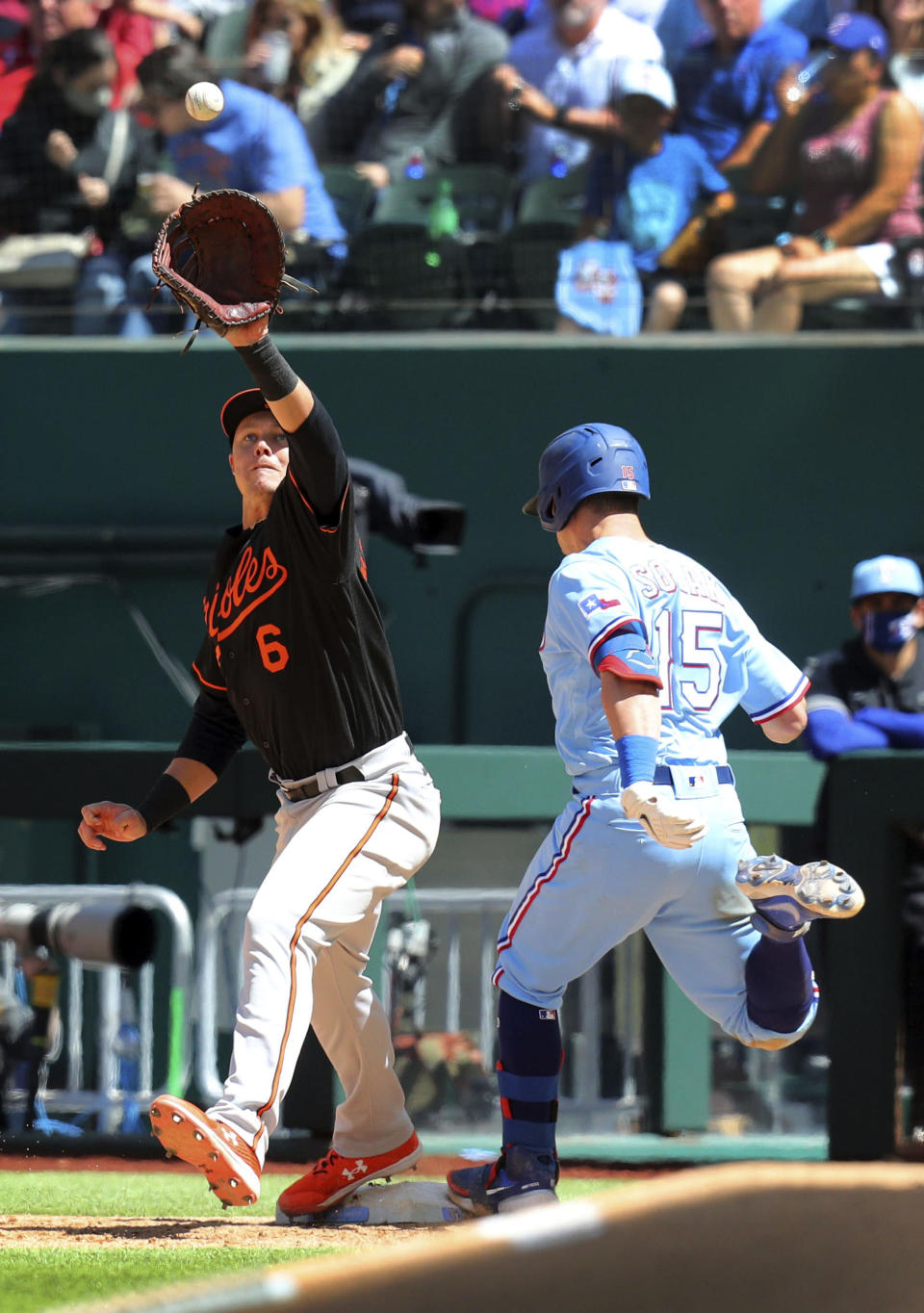 Baltimore Orioles third baseman Ryan Mountcastle (6) reaches for the ball as Texas Rangers second baseman Nick Solak (15) beats out the throw in the sixth inning during a baseball game on Sunday, April 18, 2021, in Dallas. (AP Photo/Richard W. Rodriguez)