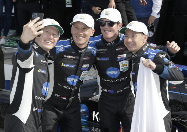 From left to right, Konica Minolta Cadillac DPi-V.R drivers Ryan Briscoe, Renger van der Zande, Scott Dixon and Kamui Kobayashi pose for a photo in Victory Lane after winning the Rolex 24-hour auto race at Daytona International Speedway, Sunday, Jan. 26, 2020, in Daytona Beach, Fla. (AP Photo/Terry Renna)