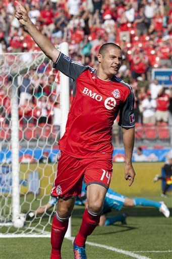 Toronto FC 's Danny Koevermans celebrates scoring his team's opening goal against the New England Revolution during first half MLS soccer action in Toronto on Saturday June 23, 2012. (AP Photo/The Canadian Press, Chris Young)