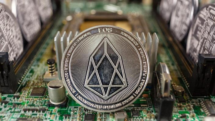 EOS coinclose-up on a computer circuit motherboard as a blockchain technology payment network.
