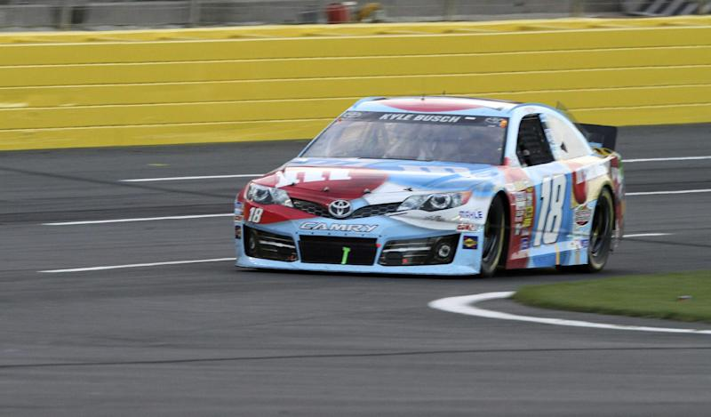 In this photo provided by Fernando Echeverria, Kyle Busch drives over a broken television camera cable during the NASCAR Sprint Cup series Coca-Cola 600 auto race at Charlotte Motor Speedway in Concord, N.C., Sunday, May 26, 2013. (AP Photo/Fernando Echeverria)