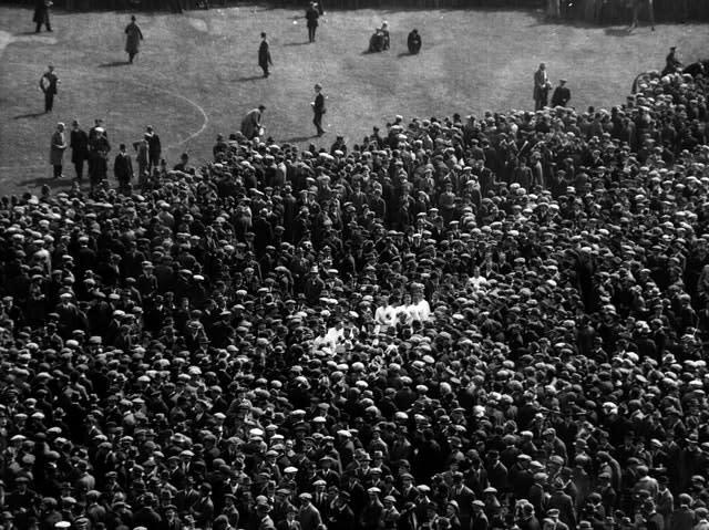 A pitch invasion at Wembley Stadium following the 1923 FA Cup final, just months after Arthur Kinnaird's death (PA Archive)