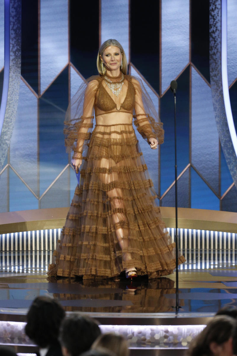 Gwyneth Paltrow walks on stage at the 2020 Golden Globes in a sheer Fendi dress