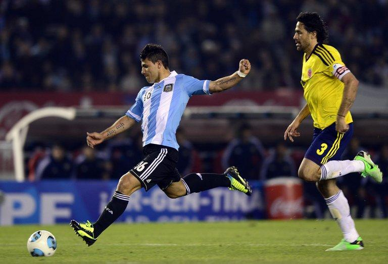 Argentina's Sergio Aguero shoots during the FIFA World Cup Brazil 2014 qualifying match against Colombia, June 7, 2013