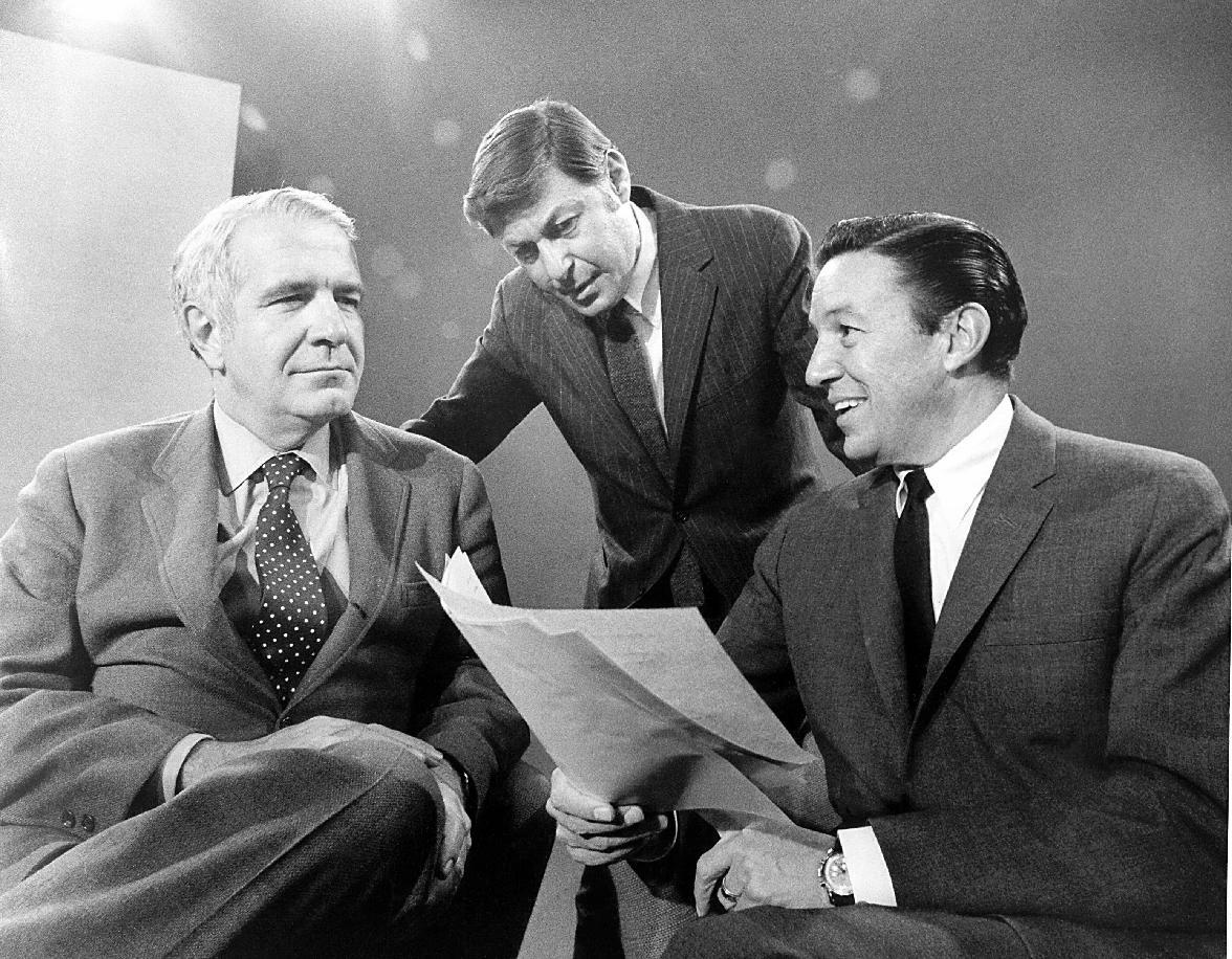 """FILE - This 1968 photo released by CBS shows """"60 Minutes"""" correspondents Harry Reasoner, left, and Mike Wallace, right, with creator and producer Don Hewitt on the set in New York. Wallace, famed for his tough interviews on """"60 Minutes,"""" has died, Saturday, April 7, 2012. He was 93. (AP Photo/CBS Photo Archive)"""
