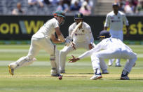 Australia's Travis Head, left, bats during play on day one of the Boxing Day cricket test between India and Australia at the Melbourne Cricket Ground, Melbourne, Australia, Saturday, Dec. 26, 2020. (AP Photo/Asanka Brendon Ratnayake)