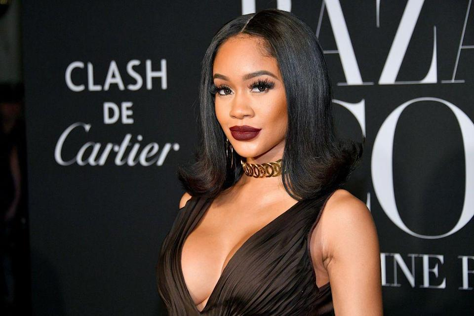 """<p>Try flipping out...your hair that is! This sleek look is big for 2021 and <strong>Saweetie</strong> shows us how it's done. The 70s are trending on runways, so it's no surprise that the """"70s big hair flip out will be popular this year,"""" Porsche reveals. </p>"""