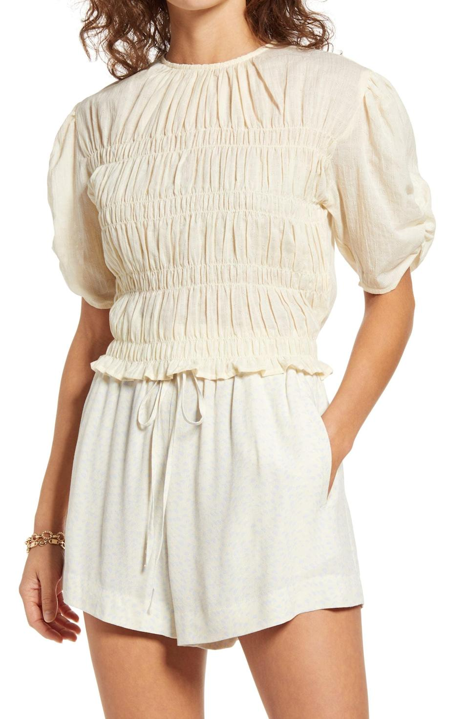 <p>The smocked panels of this <span>Open Edit Smocked Short Sleeve Top</span> ($33, originally $55) add a touch of elegance, while the puff sleeves bring drama in the chicest way.</p>
