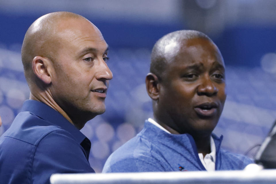 Miami Marlins CEO Derek Jeter, left, and Michael Hill, President of Baseball Operations, watch batting practice before the start of a baseball game against the Cincinnati Reds, Wednesday, Aug. 28, 2019, in Miami. (AP Photo/Wilfredo Lee)