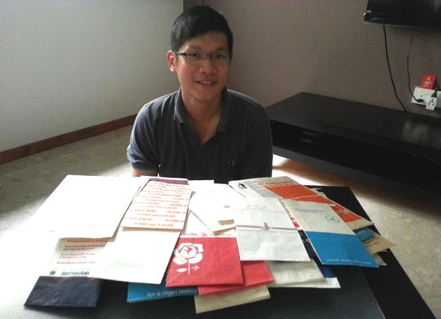hen Yinghao, 30, collects vomit bags from airlines all over the world. (Yahoo! photo/Fann Sim)