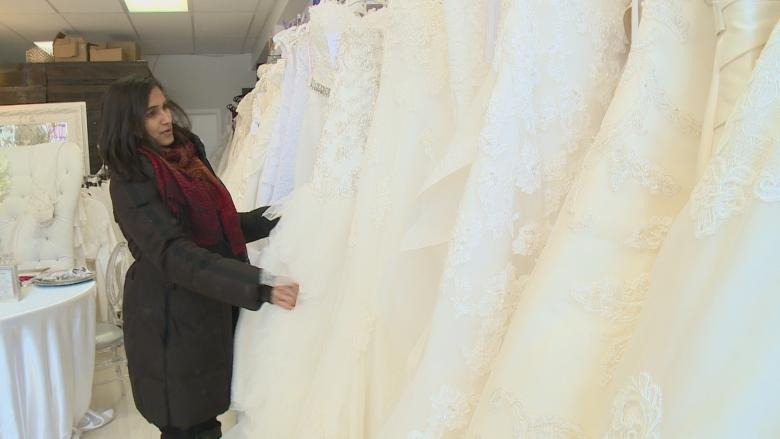 Scores of women searching for their wedding gowns as consignment store shuts its doors