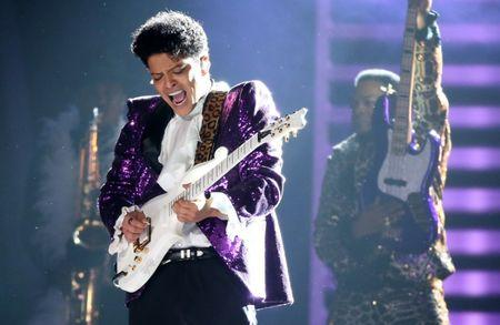 "Bruno Mars performs ""Let's Go Crazy"" during a tribute to the late singer Prince at the 59th Annual Grammy Awards in Los Angeles"