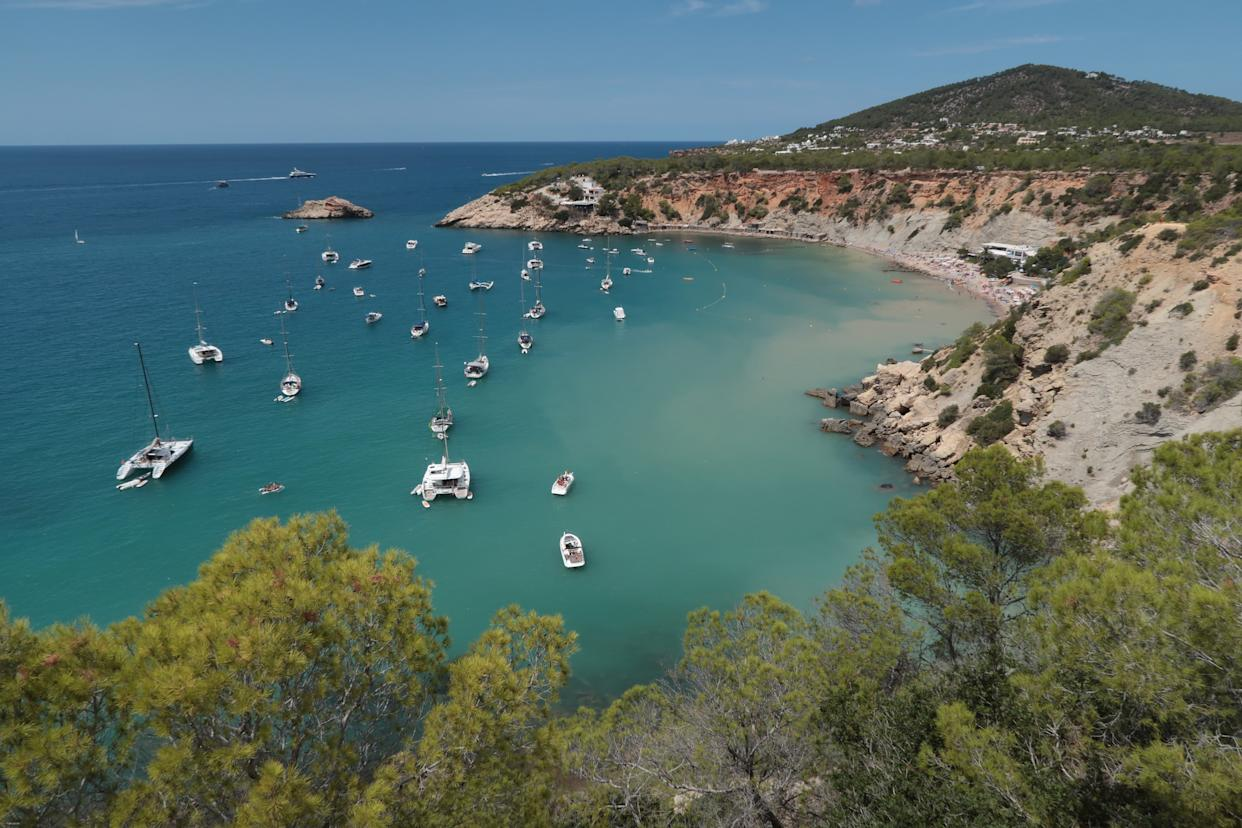 IBIZA, SPAIN - AUGUST 11:  Boats lay anchored at Cala d'Hort beach on the island of Ibiza on August 11, 2017 near Sant Josep, Spain. Ibiza is a popular tourist destination.  (Photo by Sean Gallup/Getty Images)