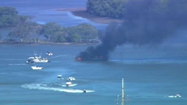 One of the boats has completely burnt to the waterline. Source: 7News