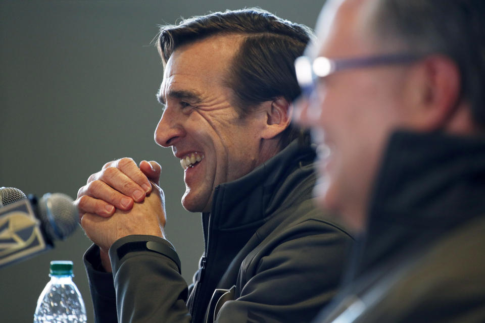 """FILE - In this Thursday, May 2, 2019 file photo, George McPhee, left, president of hockey operations with the Las Vegas Golden Knights, speaks at a news conference with new general manager Kelly McCrimmon, right, Thursday, May 2, 2019, in Las Vegas. Four years since George McPhee was a """"puppet master"""" of the NHL leading up to the Vegas expansion draft, general managers approached this trade deadline with Seattle's upcoming addition to the league in mind. While Kraken GM Ron Francis prepares – and maybe made a handshake deal or two already like McPhee did – Seattle was on his colleagues' minds. (AP Photo/John Locher, File)"""