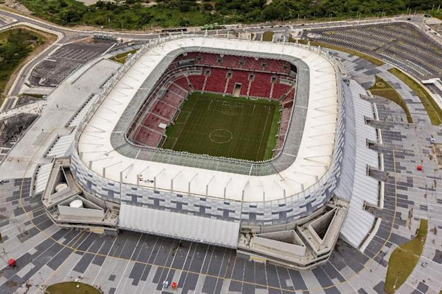 In this photo released by Portal da Copa 2014, an aerial view of the Arena Pernambuco stadium, in Recife, Brazil, Oct. 2013. The draw for the 2014 World Cup finals takes place Friday Dec. 6, 2013 near Salvador, Brazil. The 32 teams will be drawn into eight groups of four. The top two in each group will progress to the knockout stages. Twelve stadiums in twelve cities will host matches. (AP Photo/Portal da Copa 2014, Ana Araujo)