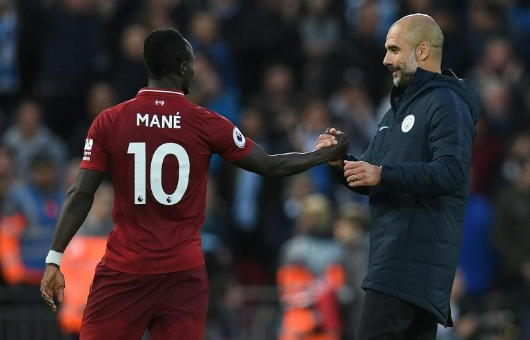 Manchester City manager Pep Guardiola (right) is confident his side can end Liverpool's long unbeaten home run