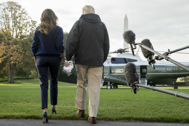 <p>President Donald Trump and first lady Melania Trump walk to board Marine One on the South Lawn of the White House in Washington, Tuesday, Oct. 3, 2017, for a short trip to Andrews Air Force Base, Md. and then on to Puerto Rico. (Photo: Andrew Harnik/AP) </p>