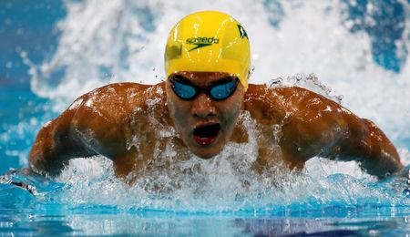 FILE PHOTO: Australia's Kenneth To competes in the men's 100m individual medley heats during the FINA Swimming World Cup 2012 in Dubai, October 2, 2012. REUTERS/Jumana ElHeloueh