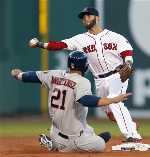 Houston Astros' Fernando Martinez (21) is forced out at second base as Boston Red Sox's Dustin Pedroia turns the double play on a hit by the Astros' Matt Dominguez in the second inning of a baseball game in Boston, Thursday, April 25, 2013. (AP Photo/Michael Dwyer)
