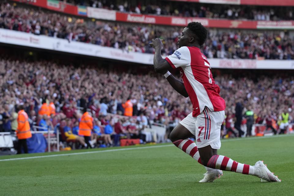 Arsenal's Bukayo Saka celebrates after scoring his side's third goal during the English Premier League soccer match between Arsenal and Tottenham Hotspur at the Emirates stadium in London, Sunday, Sept. 26, 2021. (AP Photo/Frank Augstein)