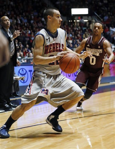 Mississippi guard Marshall Henderson (22) dribbles past Mississippi State guard Jalen Steele (0) during the first half of an NCAA college basketball game in Oxford, Miss., Wednesday, Feb. 6, 2013. (AP Photo/Rogelio V. Solis)