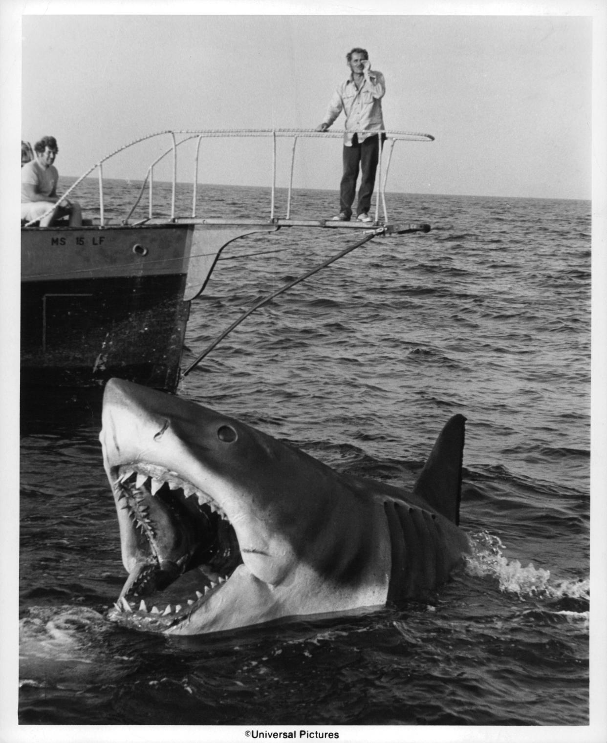 Robert Shaw stands over Jaws in a scene from the film 'Jaws', 1975. (Photo by Universal Pictures/Getty Images)