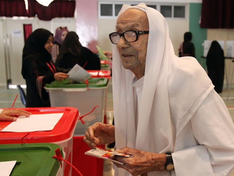 An elderly Bahraini man casts his ballot Saturday, Oct. 23, 2010, in Muharraq, Bahrain, for parliamentary and municipal elections. After months of street unrest, voters in the island kingdom of Bahrain were choosing a new parliament Saturday that could challenge the ruling Sunni dynasty's sweeping crackdown on majority Shiites. (AP Photo/Hasan Jamali)