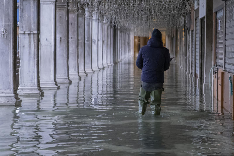 VENICE, ITALY - NOVEMBER 24: Local walks in Piazza San Marco on November 24, 2019 in Venice, Italy. Ten days after the exceptional and disastrous high tide today once again it reached 130 cm. (Photo by Stefano Mazzola/Awakening/Getty Images)