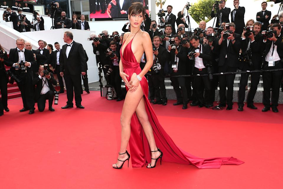 Supermodel Bella Hadid wore a daring hip-high slit dress at the Cannes Film Festival in 2016 [Photo: Getty Images]