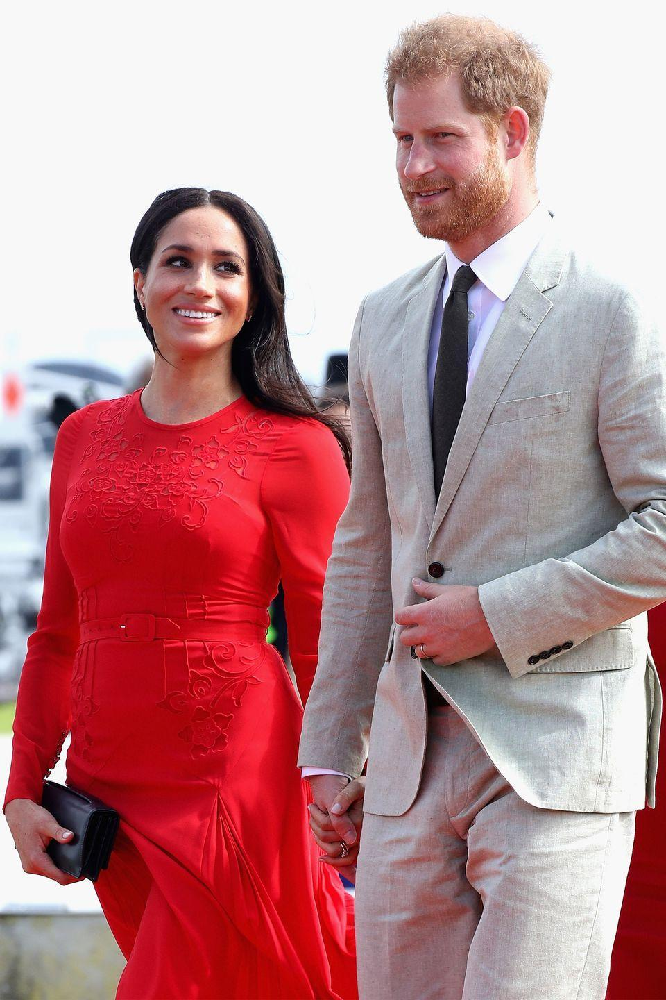<p>Meghan gave Harry a sweet side glance as they exited their plane in Nuku'alofa, Tonga. </p>