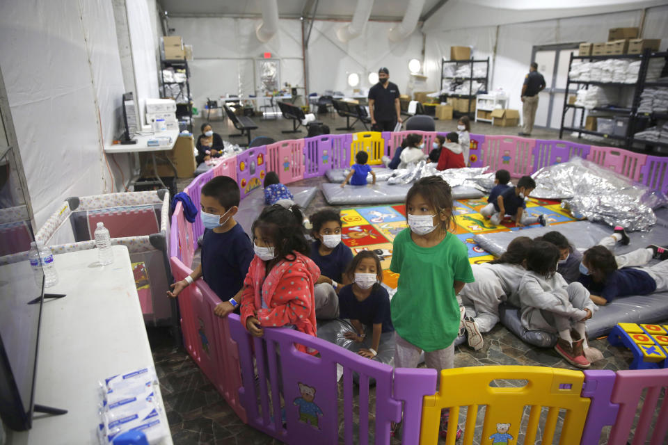 FILE - In this March 30, 2021, file photo, young unaccompanied migrants, from ages 3 to 9, watch television inside a playpen at the U.S. Customs and Border Protection facility, the main detention center for unaccompanied children in the Rio Grande Valley, in Donna, Texas. U.S. authorities say they picked up nearly 19,000 children traveling alone across the Mexican border in March. It's the largest monthly number ever recorded and a major test for President Joe Biden as he reverses many of his predecessor's hardline immigration tactics. (AP Photo/Dario Lopez-Mills, Pool, File)