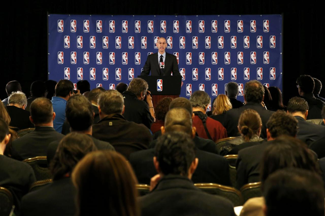 NBA Commissioner Adam Silver speaks at a news conference in New York April 29, 2014. Silver announced that Los Angeles Clippers owner Donald Sterling was banned for life and heavily fined by the NBA over racist comments he made. REUTERS/Mike Segar (UNITED STATES - Tags: SPORT BASKETBALL)