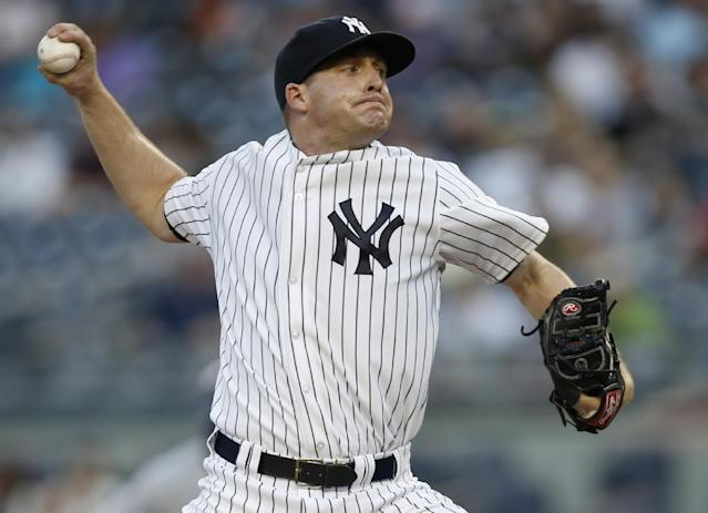 New York Yankees starting pitcher Chase Whitley delivers in a baseball game against the Toronto Blue Jays at Yankee Stadium in New York, Wednesday, June 18, 2014. (AP Photo/Kathy Willens)