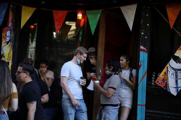 PHOTO: People drink outside a bar during the reopening phase of the coronavirus pandemic in the East Village neighborhood of New York City, June 13, 2020. (Caitlin Ochs/Reuters)