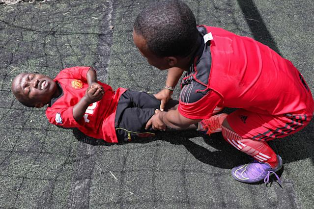 XDI11. Nairobi (Kenya), 29/05/2018.- Players of Lion Stars, Kenya's first dwarf soccer team, work out during a training session at the City Stadium in Nairobi, Kenya, 29 May 2018 (issued 14 July 2018). Lion Stars is an eight member men's dwarf soccer team, the first of their kind in Kenya, with players aged between 18 and 47 years old. Led by Gabriel Ochieng, a volunteer coach, the team aims transition from a recreational to a competitive one. They are planning to head to Argentina for the Copa Argentina tournament in October 2018 for friendly matches they have been invited to. Dwarf soccer has different rules to the mainstream version, in the interests of player safety. Headers are banned, for instance, to prevent spinal injuries, and if a player heads the ball, the other team will be awarded a free kick. Lion Stars is the only dwarf soccer team in East Africa and is working towards bringing Tanzania, Uganda and Rwanda into the fold. However, the team is facing several challenges, including financial sponsorship that would enable them to further their sporting endeavors. 'We face the challenge of ground, we face a challenge of balls, we face challenge of corns, we face challenge of uniform,' volunteer coach Ochieng said. They have reached out to the Kenyan government and well-wishers for help. The team was established with the help of the 'Short Stature Society of Kenya' to help counter stigmatization against people of short stature in the country by engaging in activities such as motivational speaking, theater, and community work as well as sporting activities such as weight-lifting, badminton and soccer. (Futbol, Amistoso, Kenia, Ruanda) EFE/EPA/DANIEL IRUNGU ATTENTION: This Image is part of a PHOTO SET