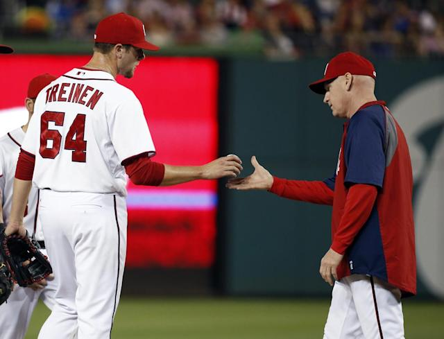 Washington Nationals pitcher Blake Treinen (64) is relieved by manager Matt Williams during the sixth inning of a baseball game against the Los Angeles Dodgers at Nationals Park, Tuesday, May 6, 2014, in Washington. (AP Photo/Alex Brandon)
