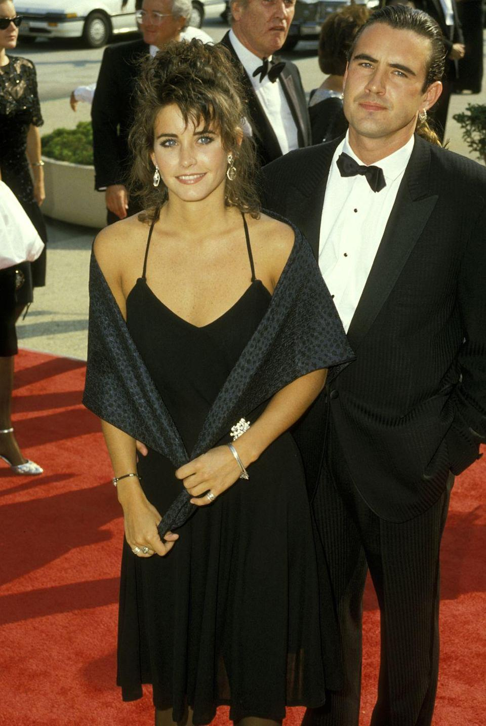 """<p>Cox walked the Emmy red carpet with her then-boyfriend Paul Brown (and a shawl)<span class=""""redactor-invisible-space""""> in 1987. </span></p>"""