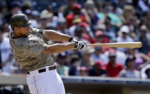 San Diego Padres' Kyle Blanks hits a home run against the Washington Nationals during the fifth inning of a baseball game in San Diego, Sunday, May 19, 2013. (AP Photo/Lenny Ignelzi)