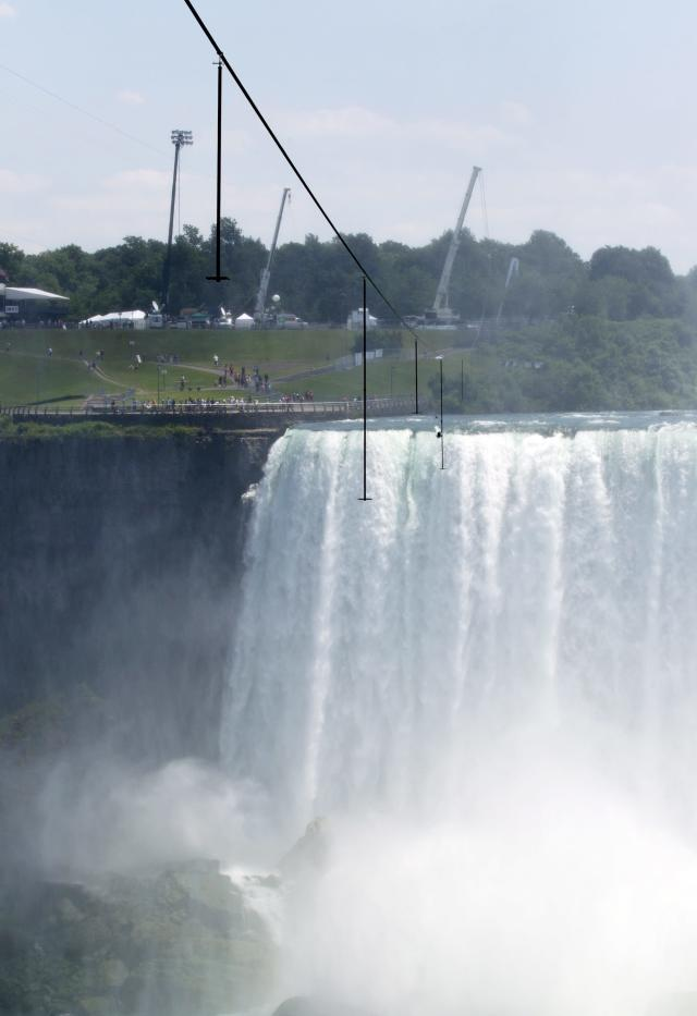 The 550 metre-long tightrope that Nik Wallenda will use hangs over Niagara Falls in Niagara Falls, Ontario, Canada., on Friday, June 15, 2012. Conditions appear good leading up to the nationally televised stunt scheduled for Friday night. When Wallenda leaves terra firm about 10:15, it should be in the low 60s with winds under 10 mph from the east, roughly at his back. (AP Photo/The Canadian Press, Frank Gunn)