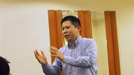 Handout photo of Chinese rights advocate Xu Zhiyong speaking during a meeting in Beijing