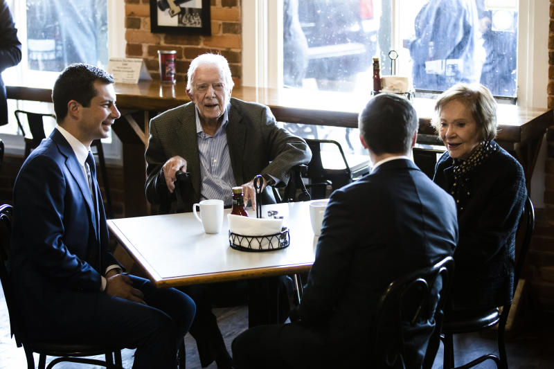 Democratic presidential candidate and former South Bend, Ind. Mayor Pete Buttigieg, left, and his husband Chasten Buttigieg, second from the right, meet with former President Jimmy Carter and former first lady Rosalynn Carter at the Buffalo Cafe in Plains, Ga., Sunday, March 1, 2020. (AP Photo/Matt Rourke)