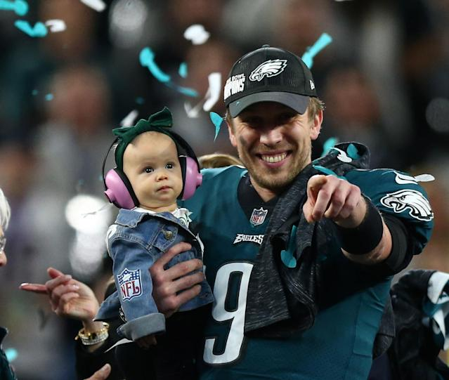 Philadelphia Eagles quarterback Nick Foles (9) celebrates with daughter Lily after defeating the New England Patriots in Super Bowl LII at U.S. Bank Stadium. Mandatory Credit: Mark J. Rebilas-USA TODAY Sports