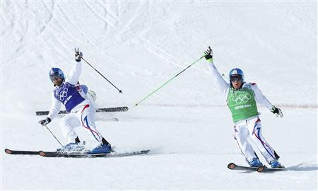 France's Arnaud Bovolenta (L) and France's Jean Frederic Chapuis cross the finish line during the men's freestyle skiing skicross final at the 2014 Sochi Winter Olympic Games in Rosa Khutor February 20, 2014. REUTERS/Mike Blake