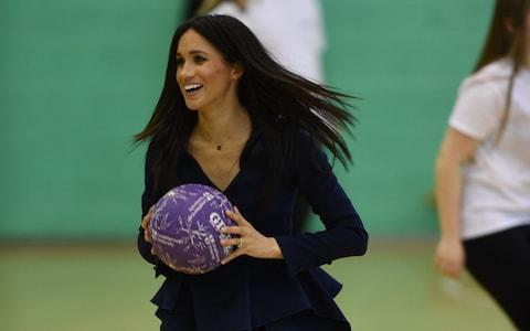 The Duchess of Sussex joins netball training - Credit: Eddie Mulholland For The Telegraph