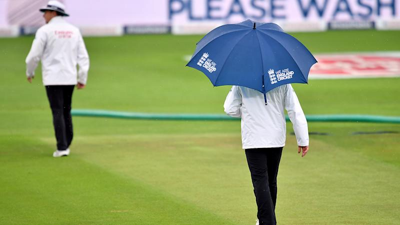 Umpires, pictured here leaving the field after an inspection.