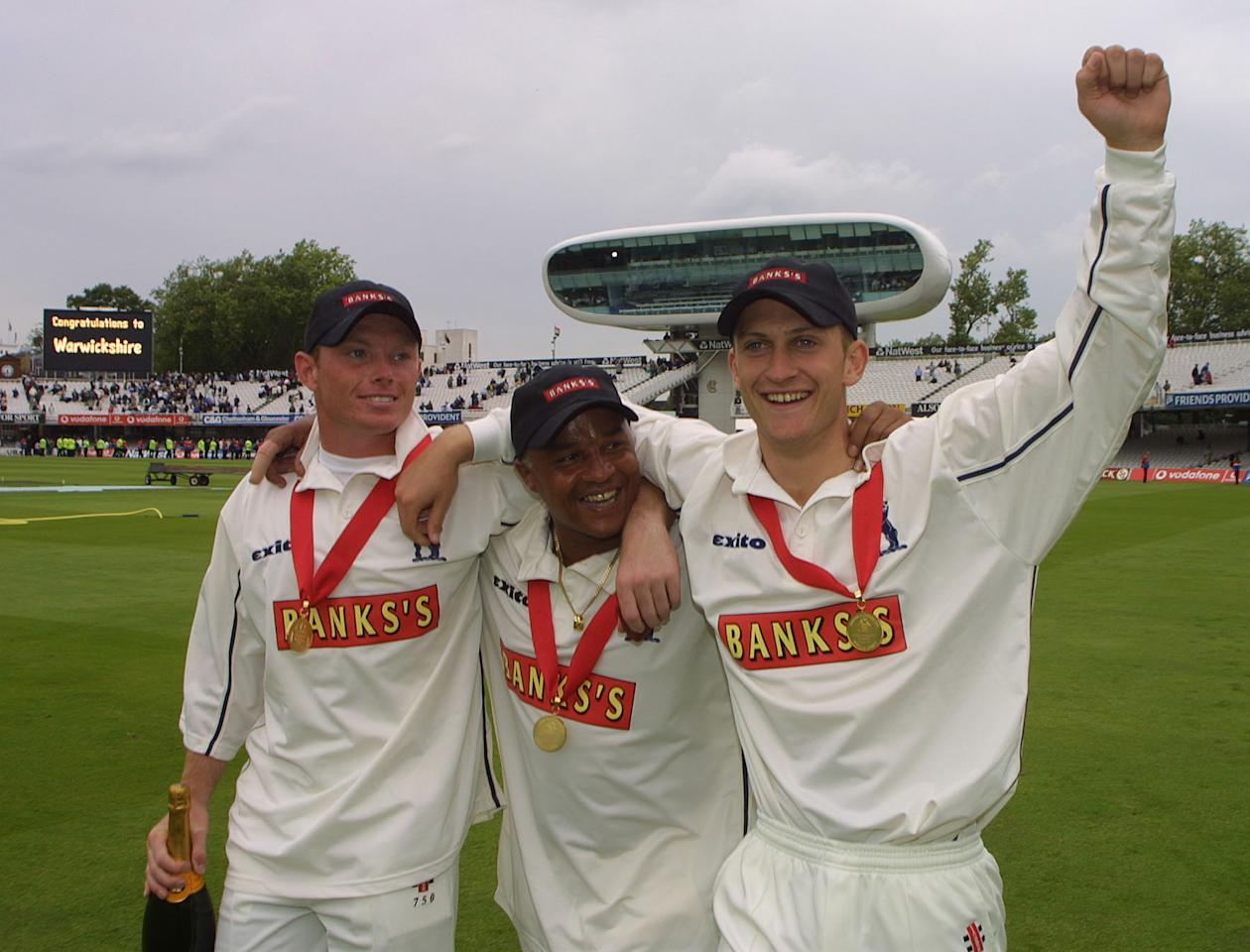 LONDON - JUNE 22:   Man of the Match Ian Bell [Left], Keith Piper [Center] and Jim Troughton [Right] of Warwickshire celebrate after beating Essex in the Benson & Hedges Cup Final between Essex and Warwickshire at Lord's, London. .     (Photo by Craig Prentis/Getty Images)
