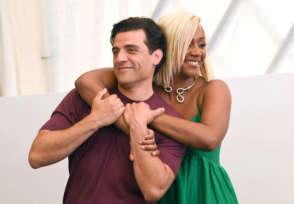 <p>Oscar Isaac and Tiffany Haddish embrace at the photocall for the film <em>The Card Counter</em> during the 78th Venice Film Festival on Sept. 2.</p>