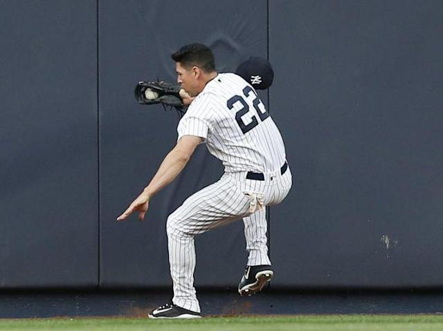Yankees center fielder Jacoby Ellsbury steadies himself after colliding with the outfield wall making a great catch. He was later diagnosed with a concussion and sprained neck. (AP)